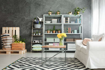 Metal and wooden decor in cozy white and grey lounge