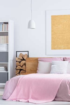 nightstand: Simple pink bedroom with cozy big bed and wood supplies