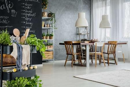 Loft space with dining zone and kitchen annex 版權商用圖片