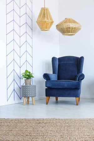 Stylish blue armchair in white living room Stock fotó - 82160770