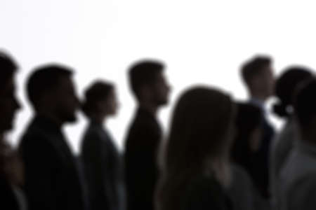 Group of people, black silhouettes and white background Stock Photo