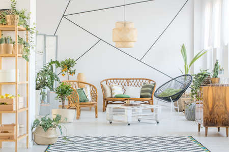Decorative tape on a wall in white living room with rattan accessories