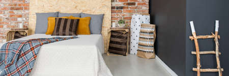Cozy wooden style bedroom with red brick wall Stock Photo