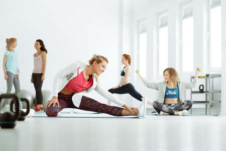 Happy women talking and laughing during stretching