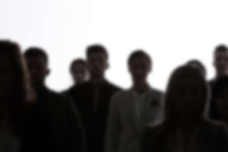 Crowd of people silhouettes standing on white background