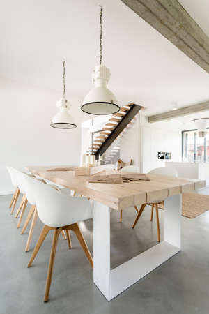 Wooden, fancy dining table in open living space