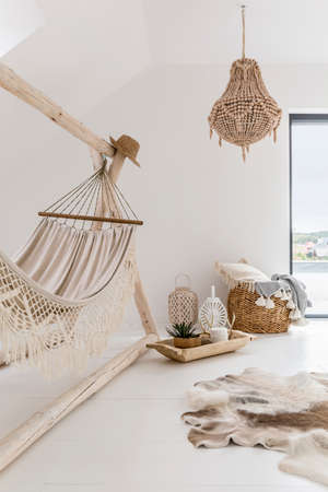 Dreamy white chill zone with hammock and rustic accesories