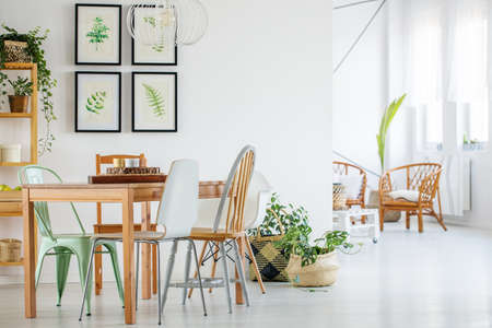 Wooden table and chairs in modern apartment interior
