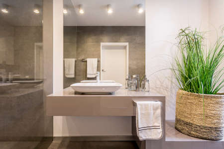bathroom design: Simple but stylish lavatory with glass wall Stock Photo