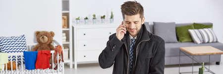 Room interior with elegant man making a phone call Banco de Imagens