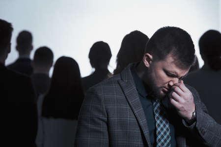 Man in despair and anonymous crowd of people 版權商用圖片