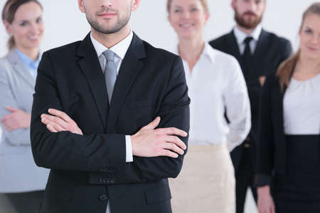Group of smiling businessmen and businesswomen standing Stock Photo
