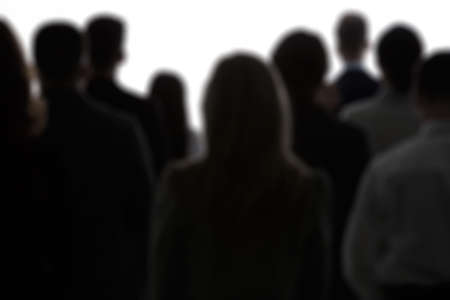 Crowd of people, black silhouettes and white background Stock Photo