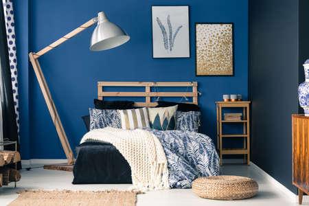 Stylish bedroom interior with dark blue wall Stock Photo