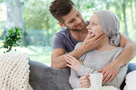 Handsome man supporting his sick wife during chemotherapy Stock Photo