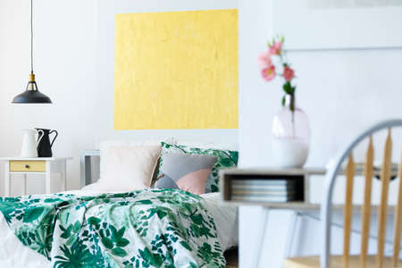 oil lamp: Pastel bedroom with contemporary artworks and stylish furniture