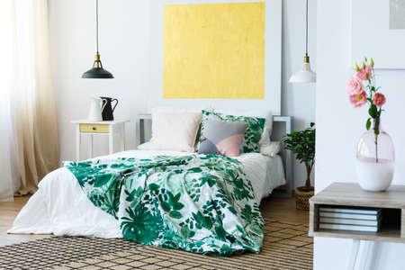 Yellow abstract painting above the bed in stylish bedroom Stock Photo - 82253955