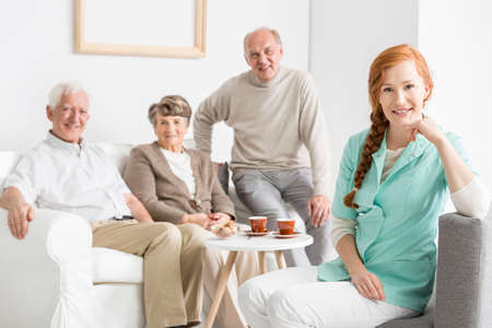 Photo of young nurse and seniors spending time together Reklamní fotografie
