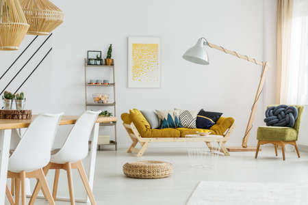 Round wicker footrest lying on the floor in living room Stock Photo