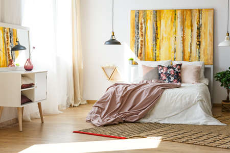 Nice and stylish bedroom in warm colors Stock Photo