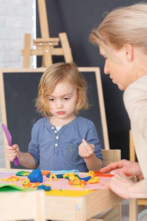 Little girl having fun at school during art classes