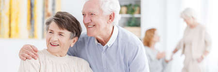 Elder happy man and woman hugging and smiling