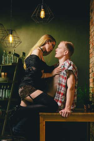 Sexy beautiful woman seducing lumberjack style man