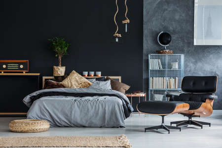 Wicker accessories in black and grey modern bedroom Stock Photo