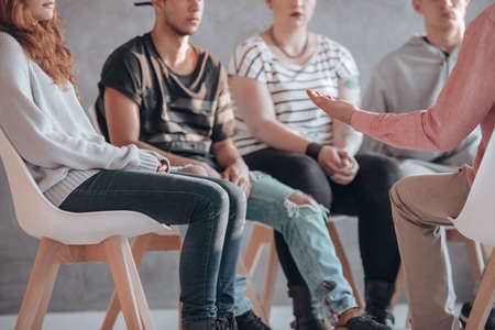 Rebellious youth being treated at a psychotherapy meeting