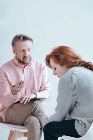 Therapist reaching out to his patient in order to help Stock Photo