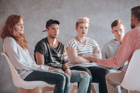 Troubled youth having a therapeutic session with a counselor Stock Photo