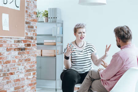 Rebellious girl bursting with anger at her therapist Stock Photo