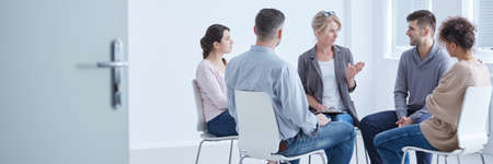 People discussing problems with psychologist during depression group therapy Stock Photo - 82347426