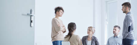 Support group watching young couple emotionally focused during drama therapy Stock Photo - 82347492