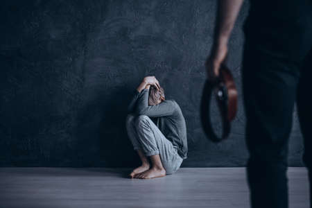 Heartbreaking, conceptual photo of son beaten by his own father