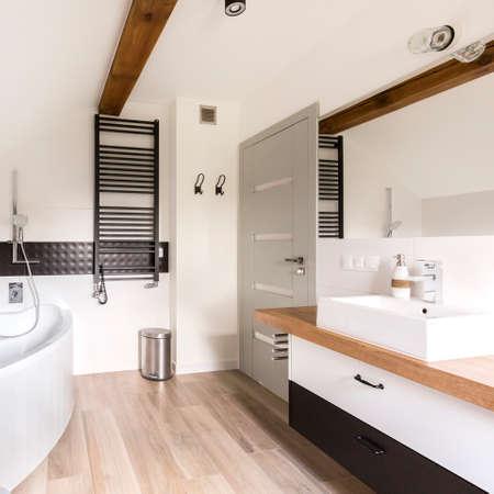 bathroom design: Modern spacious bathroom in black and white decor with a big bath