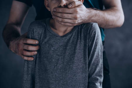 Scary, conceptual photo of terrified kidnapped boy Stok Fotoğraf - 82361389