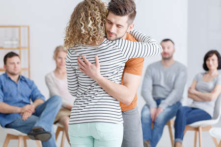 Hugging during support group meeting in rehab