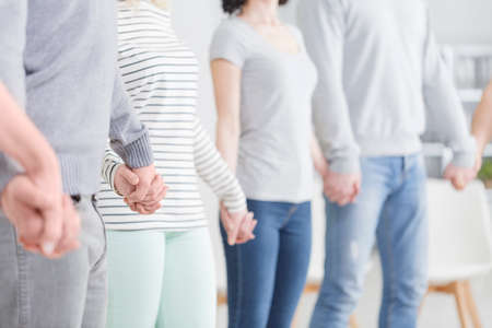 People holding hands during support group meeting Stock Photo - 82361765
