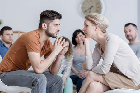 Two people during behavioral  psychotherapy in group
