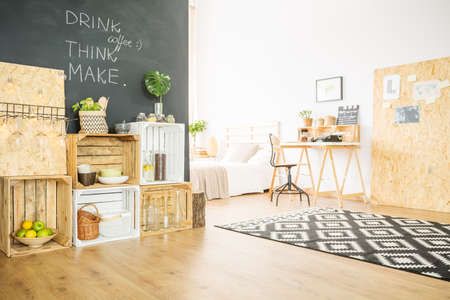 Upcycled hipster flat with DIY wooden furniture and blackboard