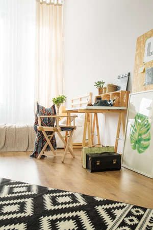 Workspace for young hipster with simple wooden furniture