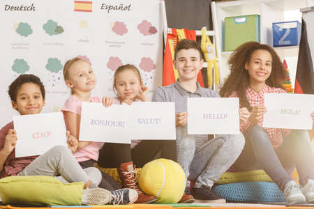 Group of children studying foreign languages in school Stock Photo