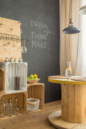 Upcycled interior with blackboard and DIY furniture Stock Photo - 82490361