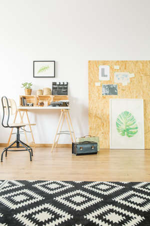 Ucycled studio flat with minimalist graphics workspace Stock Photo
