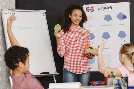 Young pretty woman as a teacher on english classes Stock Photo