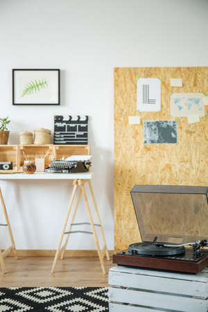 Hipster interior with gramophone and DIY furniture