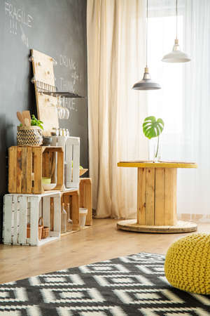 Modern interior with DIY furniture from wooden boxes