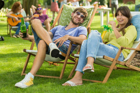Young couple having fun on bbq party Stock Photo