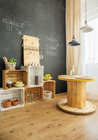 DIY furniture from wooden crates and cable stool in upcycled interior